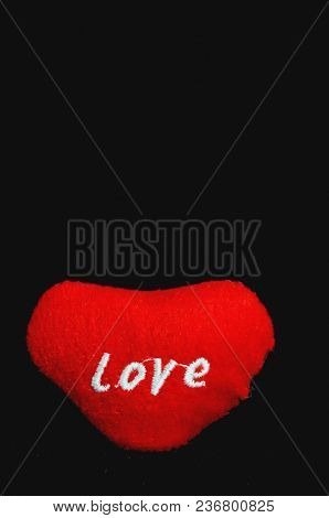 Love Concept Red Cloth Heart Isolated On A Black Background
