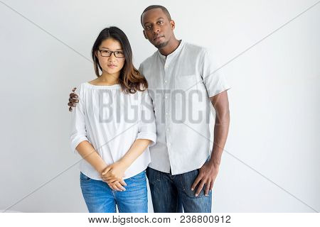 Serious Beautiful Young Multiethnic Couple In Casual Outfits Looking At Camera. Confident African Gu