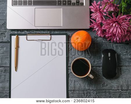 Bouquet Of Flowers, Notebook, Cup Of Coffee, Orange And Pen On Wooden Table. Work At Home.