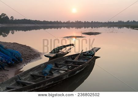 Fishing Boat Parking On The Riverside Evening Clouds On Sunset, Roi Et, Thailand