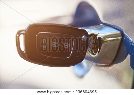 Modern Car Key Inserted In Handle Macro Close Up