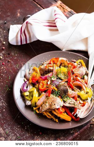 Close-up Of Plate With Warm Salad With Roasted Chicken Liver, Red And Green Bell Sweet Pepper, Onion