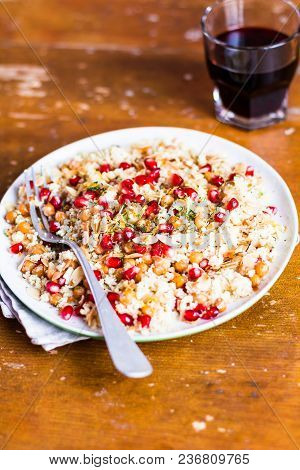 Traditional East Asian Meal. Plate Of Warm Salad With Couscous, Chickpea, Pomegranate Seeds, Lemon Z