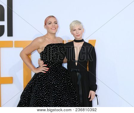LOS ANGELES - APR 17:  Busy Philipps, Michelle Williams at the