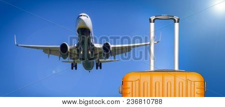 Travel Concept. Suitcases And The Boarding Plane In The Blue Sky