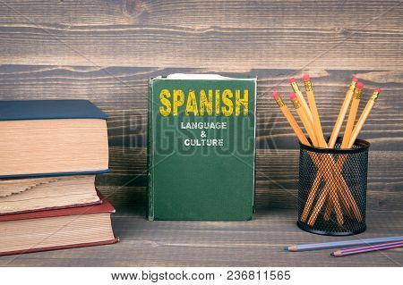 Spanish Language And Culture Concept. Book On A Wooden Background