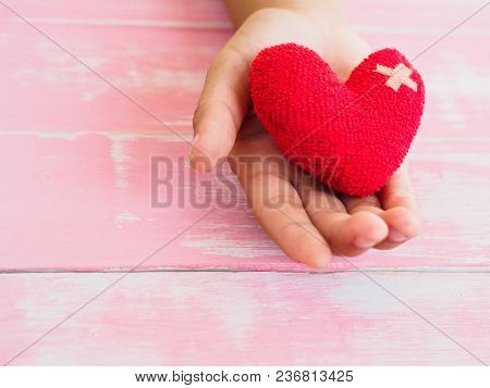 Valentine, Health, Medicine And Charity Concept.  Heart On Aging Kid Hand Support