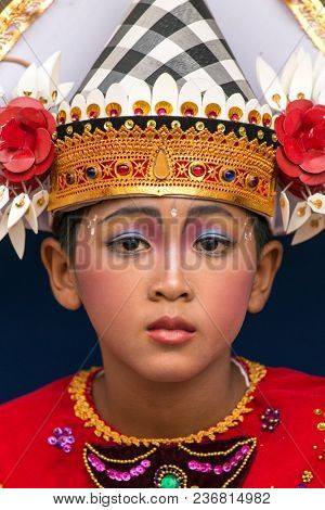 Bali, Indonesia - September 17, 2016: Portrait of an unidentified balinese young artist ready for Galungan celebration in Ubud, Bali.
