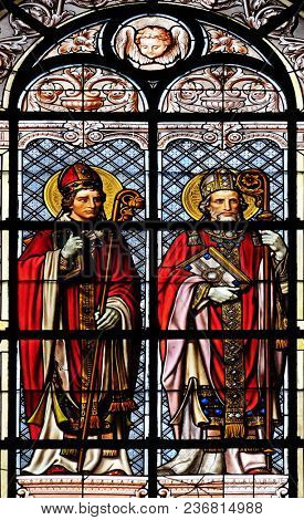 PARIS, FRANCE - JANUARY 10: Saint Hilarius and Saint Augustine, stained glass window in the Saint Augustine church in Paris, France on January 10, 2018.