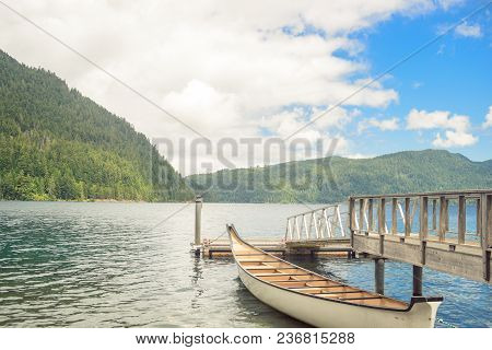 Wooden Boat Pier On Serene Beautiful Mountain Lake