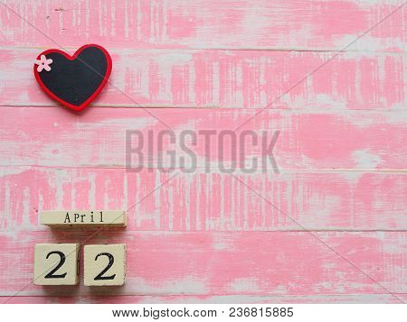 Wooden Block Calendar For World Earth Day April 22,wooden Block Calendar And Wooden Heart Board On B