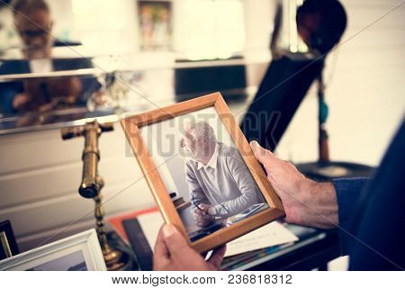 Closeup of hands holding photo frame