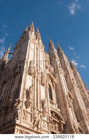Some Statues Of The Milan Cathedral With A Clear And Blue Sky