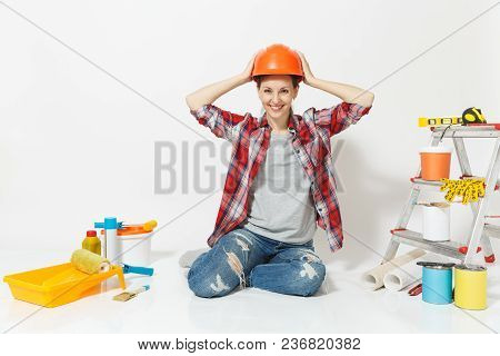 Woman In Orange Protective Helmet Sitting On Floor With Instruments For Renovation Apartment Room Is