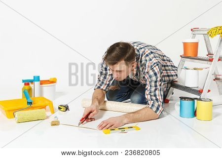 Man Sitting On Floor With Wallpaper Roll, Stationery Knife, Instruments For Renovation Apartment Roo