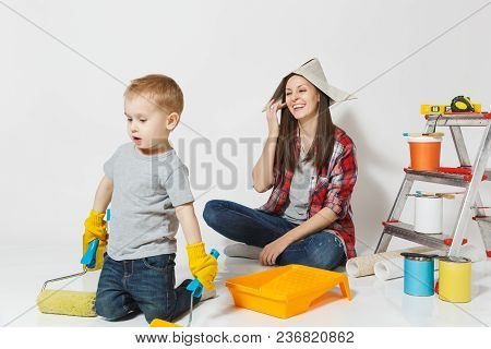 Mother And Small Son With Instruments For Renovation Apartment Room Isolated On White Background. Wa