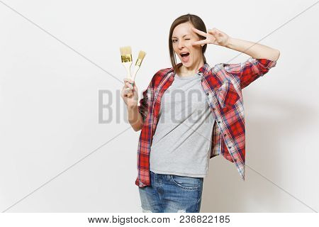 Young Fun Beautiful Woman In Casual Clothes Holding Paint Brushes And Showing Victory Sign Isolated