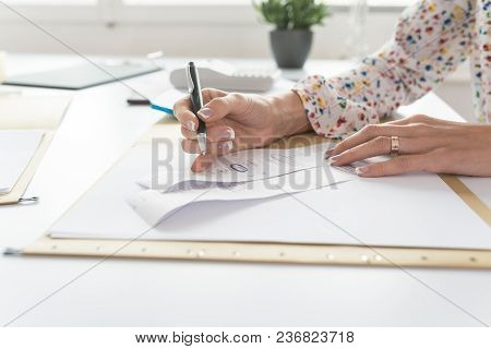 Accountant Or Financial Adviser Checking And Comparing Receipts While Making A Final Report, Working