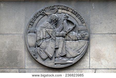 PARIS, FRANCE - JANUARY 11: Leonardo da Vinci, was an Italian Renaissance polymath. Stone relief at the building of the Faculte de Medecine Paris, France on January 11, 2018.