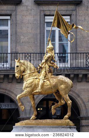 PARIS, FRANCE - JANUARY 11: Golden statue of Joan of Arc on horseback in Paris near Louvre Museum in Paris, on January 11, 2018.