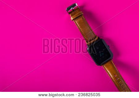 Smart Watch With Leather Strap On A Colored Pastel Background