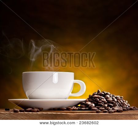 Cup of coffee with coffee beans on a beautiful brown background.