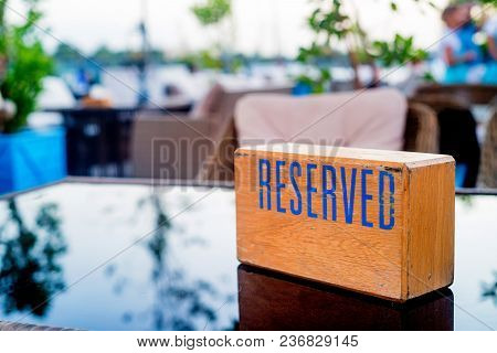 Big Table At Retaurant Served For Upcoming Banquet With Reserved Sign