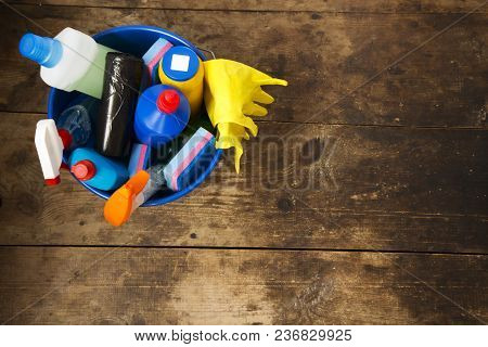 Cleaning Products On Wooden Background. House Cleaning Concept. Top View. From Above. Copy Space.