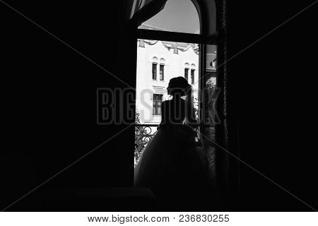 Silhouette Of Charming Bride In Ther Wedding Morning.