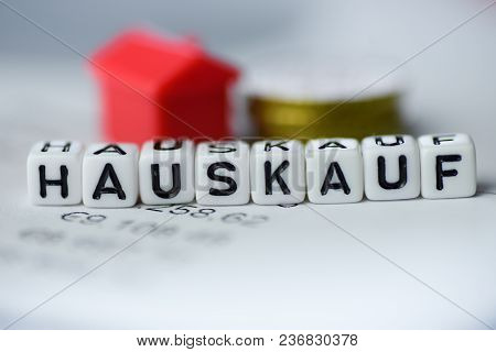 German Word House Purchase Formed By Alphabet Blocks: Hauskauf Real Estate Business