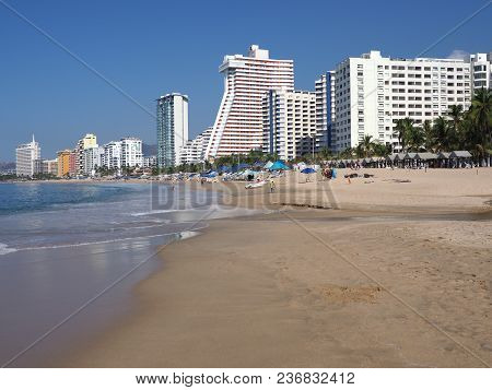 Panorama Of White Hotel Buildings On Beauty Sandy Beach At Bay Of Pacific Ocean In Mexican Acapulco