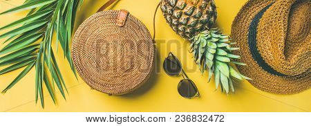 Colorful Summer Female Fashion Outfit Flat-lay. Straw Hat, Bamboo Bag, Sunglasses, Palm Branches, Pi