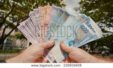 Photo Of Hands Holding Bundle Of Blue Money In Cash Of One Thousand Philippines Peso As If Being Ric