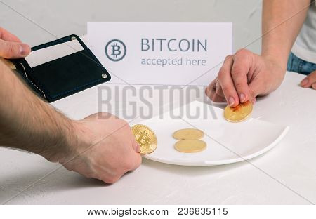 Payment For The Purchase Of A Crypto Currency: The Buyer Puts Metal Coins Bitcoin In The Cash Dish.