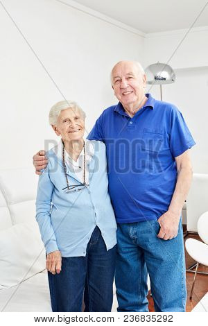 Retired couple as happy couple retired in their own apartment