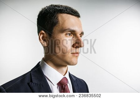 Three-quarter Portrait Of Businessman With Serious Face. Confident Professional With Piercing Look I