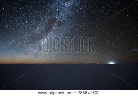Night starry sky over the salt flat of Salar de Uyuni, Altiplano, Bolivia