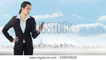 businesswoman with phones in cityscape