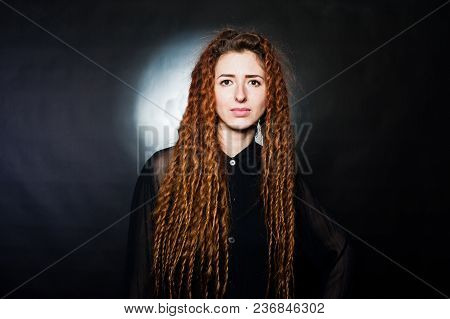 Studio Shoot Of Girl In Black With Dreads At Black Background.