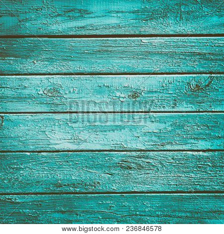 Old Wooden Boards With Peeling Cracked Turquoise Color Paint. Shabby Chic Wood Vintage Background