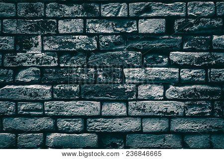 Old Shabby Painted Brick Wall. Aged Dark Brickwork Texture. Gloomy Grunge Background