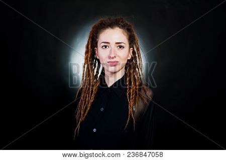 Studio Shoot Of Girl In Black With Dreads At Black Background With Nimbus.