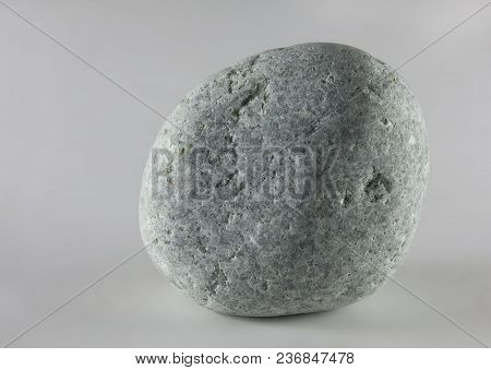 Wild Pebble Stone Isolated On White Background. Jadeite Stone.