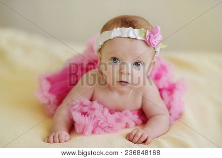 Adorable Baby Girl Wearing Tu-tu Skirt On The Bed