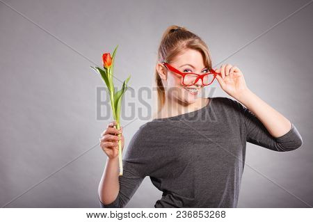 Spring Time. Craziness And Fun Concept. Playful Happy Girl Playing With Flower. Joyful Smiling Funny