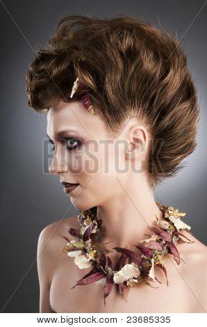 Attractive fashion portrait with floristic necklace.