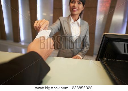 Close-up Image Of Receptionist Giving Electronic Key To Guets