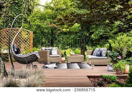 Hanging Chair On Wooden Patio