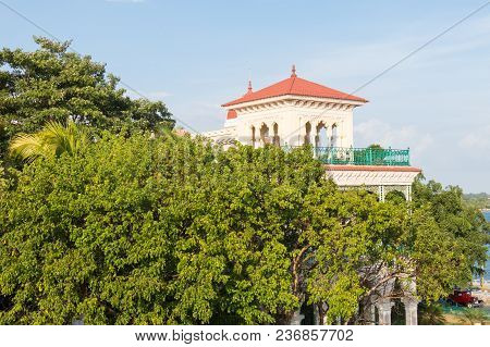 Beautiful Architecture Of The Fifties In The Trees, On The Seafront Of The City Of Cienfuegos, Islan