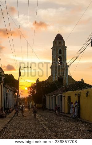 Trinidad, Cuba - January 25, 2017: Cubans Walk Through The Streets With Cobblestones In A Beautiful